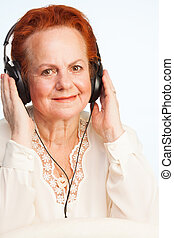 Old lady listening to music - positive old lady listening to...