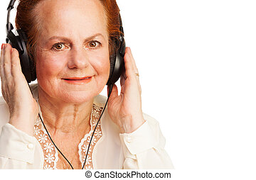 Positive retired woman listening to music - Positive retired...