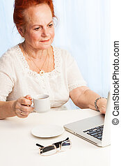 Old lady reading her email - Confident old lady sitting...