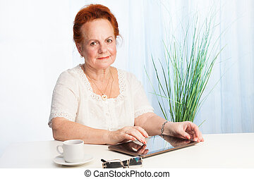 Comfortable with new technologies - senior lady with her new...