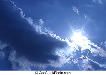 Blue clouds - The sun stands behind the blue and white...