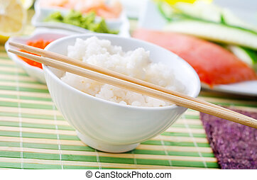 Boiled rice with ingredients for sushi