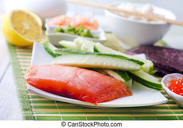ingredients for sushi, salmon and cucumber