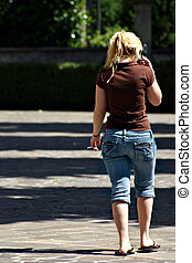 Woman with sigarette and mobile phone - A blonde woman is...