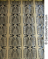Art Deco - The Art Deco pattern above the entrance to a...