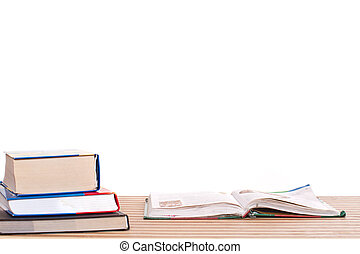 textbooks - books on a table on a white background