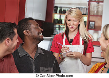 Waitress Taking Orders at Cafe - Teenage waitress taking...