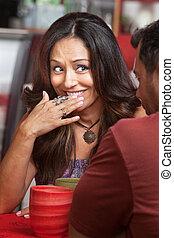 Embarrassed Lady Smiling - Bashful Hispanic woman across...