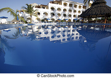 Tropical Holiday - Tropical resort with blue swimming pool