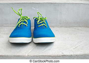 blue sneaker - brand new blue sneaker in front view on...