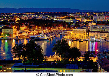 Zadar luxury yacht marina night view, with cityscape,...