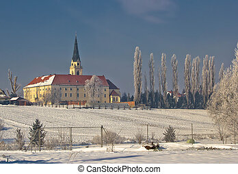 Greek catholic cathedral in snow landscape, Krizevci,...