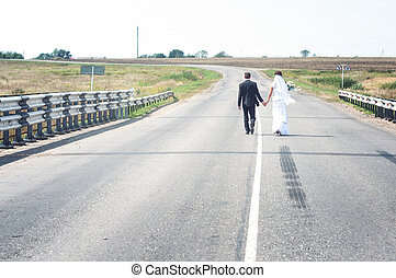 newly married couple goes on the ro - newly married couple...