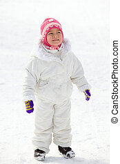 Child in winterwear - Happy girl in winterwear standing in...