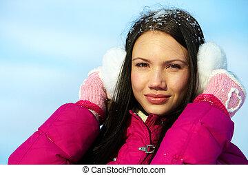 Female in winterwear - Portrait of pretty girl looking at...