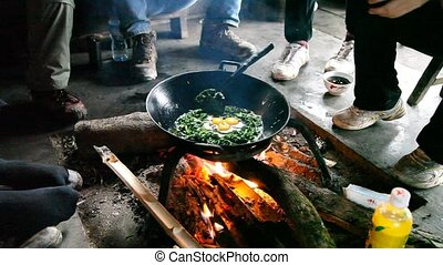 Cooking on the floor in a hut - Cooking in authentic hut in...