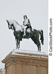 equestrian statue of Giuseppe Garibaldi hero under snow at Rome in Italy