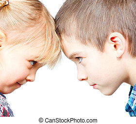Children face to face - Sister and brother looking at each...