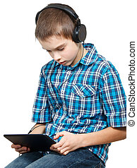 Kid playing with a tablet computer - Portrait of 10 years...
