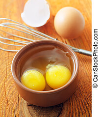 raw eggs in the brawn bowl, Yolks