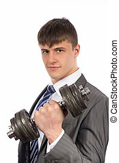 Young businessman with dumbbells