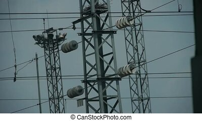 High-voltage wire tower in urban city,scenery outside...