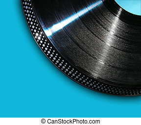 Record Playing On Blue Background - A black isolated record...