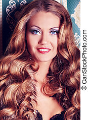 frizz hair - Beautiful glamorous woman posing at studio.