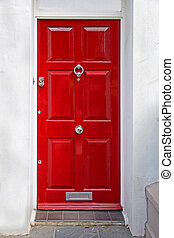 Retro red door - Red entrance door in front of residential...