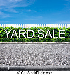 Yard sale sign on the road side