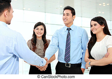 business people shaking hands - A business team with...