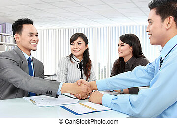 business team making a deal - Portrait of successful...