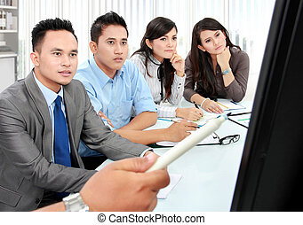 business team during presentation in the meeting room