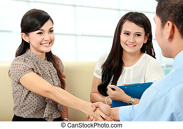 business colleagues shaking hands after interview - Portrait...