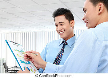 businessmen discussing a business chart growth