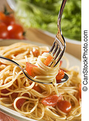 spaghetti - fresh spaghetti on fork and spoon close up shoot...