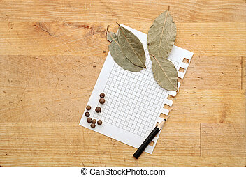 paper for notes and spices on wooden table