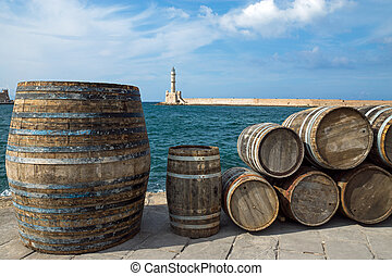 Barrels in the port of Chania - Old wooden barrels in the...