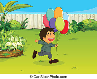 A smiling boy with balloons