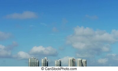 Movement of clouds in sky,building high-rise at urban city.