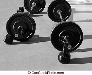 Kettlebells at Cross fit gym with lifting bar weights...