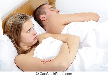 Sexual issues - Couple lying in bed having sexual issues.