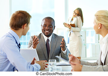 Explanation - Portrait of confident boss interacting with...