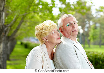 Rest in park - Mature woman and her husband flirting outside