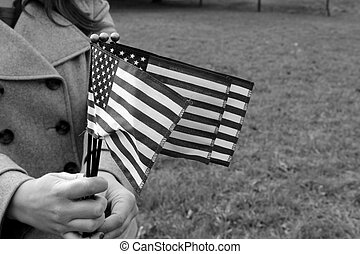 Hands holding waving flags - Three flags waving in the...