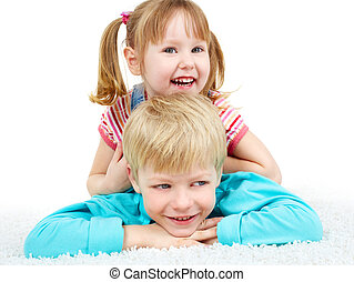 Joy - Two happy kids lying on the floor and laughing
