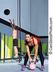 Cross fit gym Kettlebell woman and wall ball man - Cross fit...
