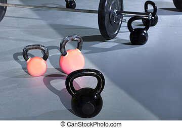 Kettlebells at Cross fit gym with lifting bar in background