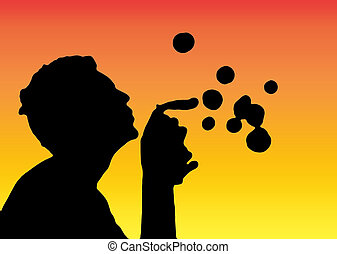 blowing bubbles - The silhouette of a teenager blowing...