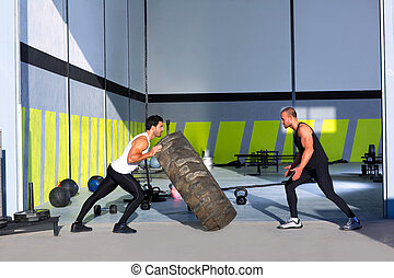 Cross fit flip tires men flipping each other the wheel...